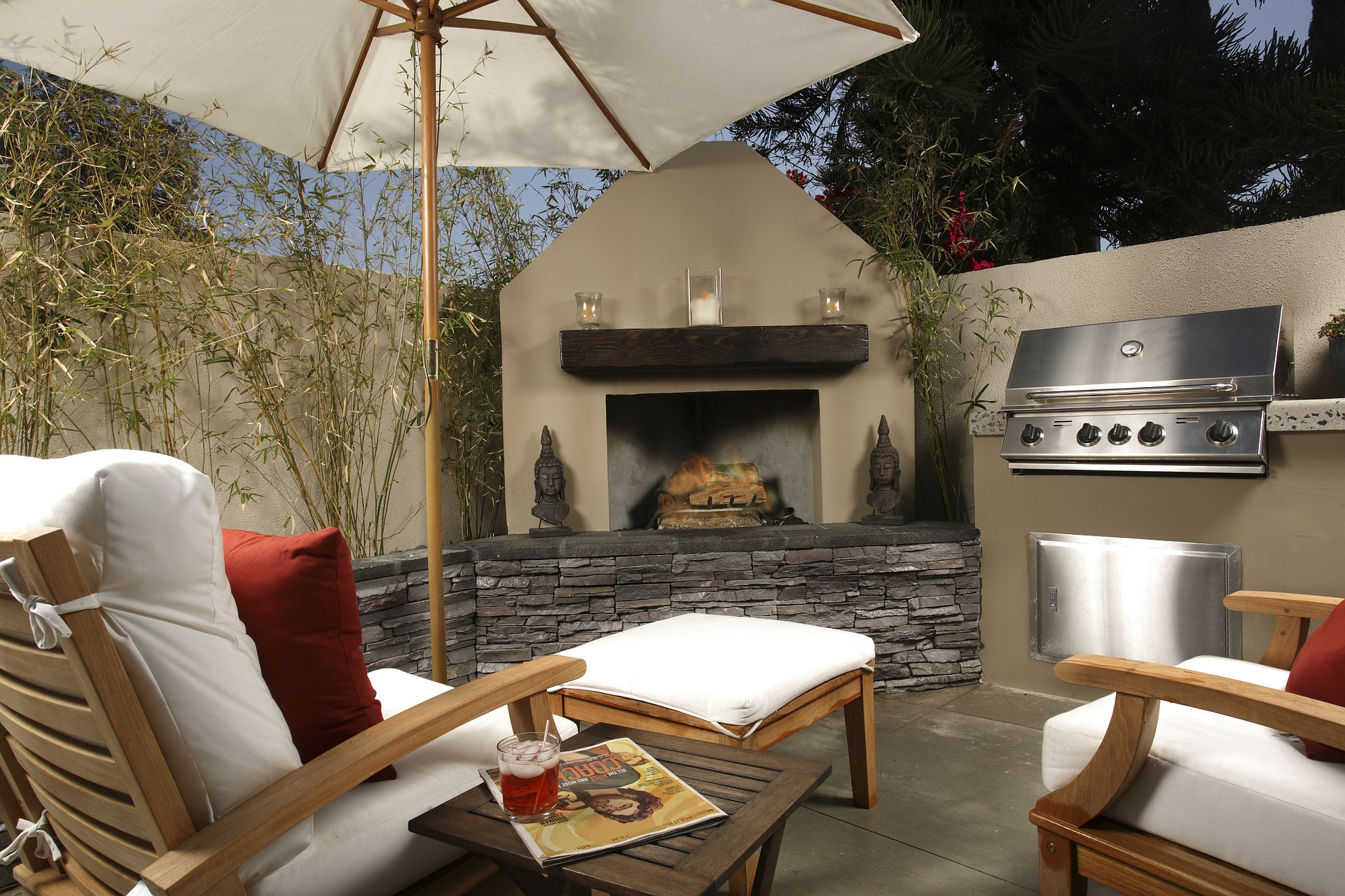 outdoor living room with barbecue, furniture, and fireplace